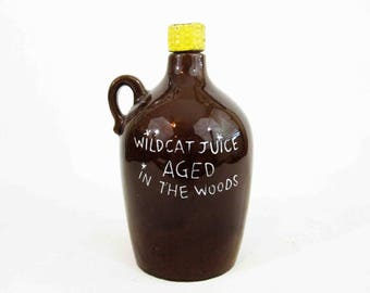 "Vintage ""Wildcat Juice Aged in the Woods"". Brown Moonshine Liquor Jug. Circa 1950's."
