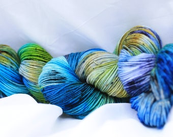 hand painted super wash  merino, speckled sock yarn fingering weight 95 grams 3.4 oz