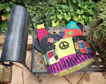 Vintage peace sign shoulder bag in bright colors ethnic cross body slouch bag back to school