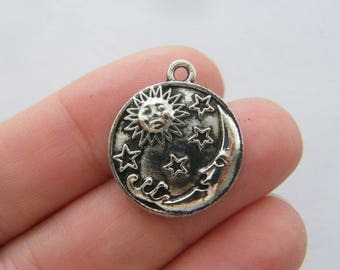 4  Moon sun stars charms antique silver tone M79