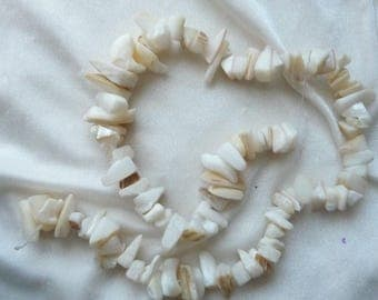 Bead, mother-of-pearl shell (natural / bleached / dyed), Natural Bleached, small to gigantic chip,  Sold per 16 inch strand.