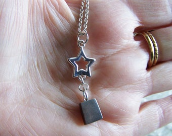 Extraterrestrial Gibeon Meteorite with Silver Star Celestial Pendant Necklace