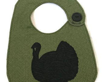 Green print bib black turkey appliqué