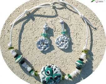 Celtic ornament: triskell and satin bows and lampwork beads
