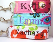 3 kids name tags (1 set).  The design includes child's (one) name on one side.  Great for luggage, backpacks, toys, etc
