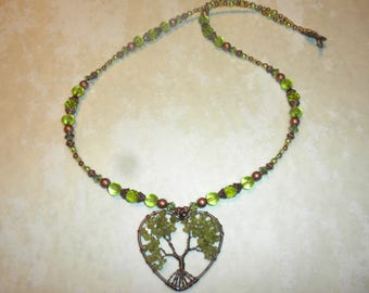 Wire Wrapped Peridot And Copper Tree Of Life Heart Necklace