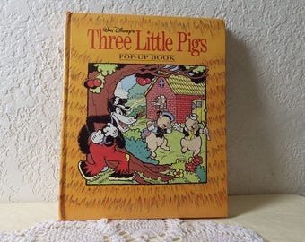 Walt Disney's Three Little Pigs. Pop-Up Book, 1993. Near New Condition. All pop ups and pull tabs work.