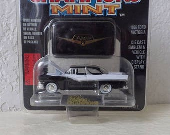 Die Cast 1956 Ford Victoria Vehicle with stand and Fairlane Emblem. Racing Champions Mint. Collectible. 1:60 Scale.