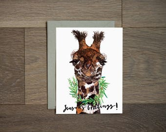 Funny holiday card: Season's Greetings Giraffe with holiday wreath
