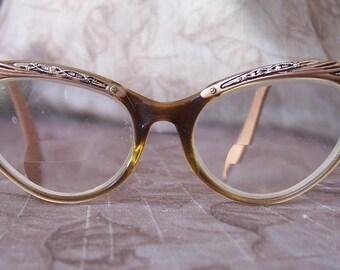 Vintage pair of fancy eyeglasses.  C3-611-1