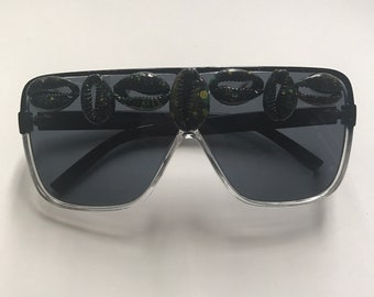 Under the surface. Sunglasses- handpainted cowrie shells