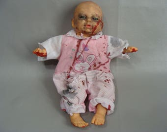 Creepy Alien Face Baby doll. Bloody Zombie Doll. Creepy Doll. Possessed Doll. Halloween Costume Accessory. Haunted House Prop. Scary Doll