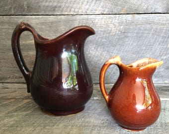 pair of vintage pottery pitchers