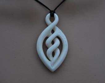 Celtic twist & Maori harvest symbol hand carved in bone, symbolising eternal bonding and abundance