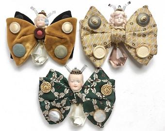 ONE vintage bow tie butterfly doll ornament handmade original art assemblage fairy mixed media art by Elizabeth Rosen