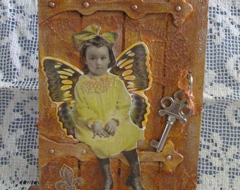 whimsical display vintage photography little girl butterfly home decor book shelf display All find what they truly seek inspirational