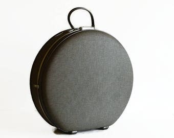 vintage round gray suitcase hat box with key 1960s American Tourister luggage