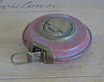 French leather cased cloth tape measure
