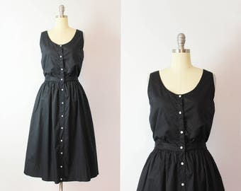 vintage 80s dress / 1980s minimalist black sundress / sleeveless midi dress / button down black cotton dress / Saks dress