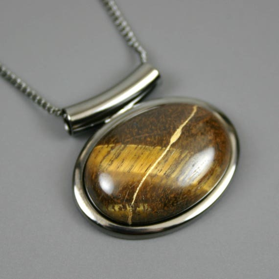 Kintsugi (kintsukuroi) tiger eye stone cabochon with gold repair in a gunmetal plated setting on gunmetal chain - OOAK