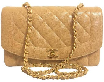 MINT. Vintage Chanel brown beige caviar leather 2.55 flap shoulder bag with golden CC closure. Must have purse.