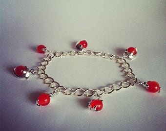 Red glass bead bracelet with Dolphin charms