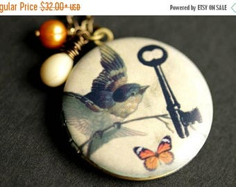 BACK to SCHOOL SALE Key Bird Butterfly Locket Necklace. Bird Necklace with Beige Teardrop and Orange Fresh Water Pearl Charm. Orange Butterf