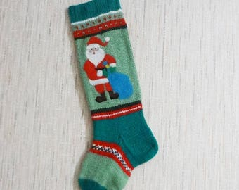 Christmas sock. Hand knitting, a gift for Christmas.