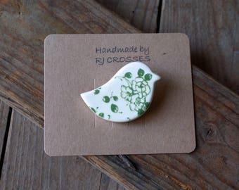 Green ceramic bird brooch