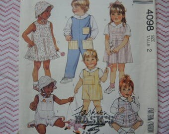 vintage 1980s McCalls sewing pattern 4098 toddlers' jumper or sundress, overalls shortalls shirt hat and toys UNCUT size 2