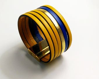 yellow, cobalt and gold leather with magnetic gold cuff