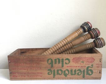 Vintage wooden bobbins in Glendale Club wooden cheese box