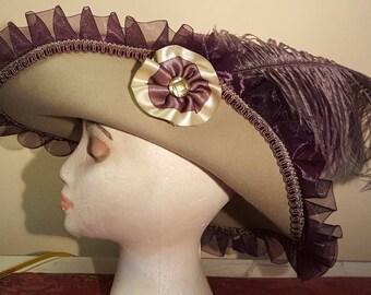 Tan cavalier with purple trim