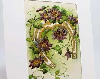 Happy Birthday Greeting Card Featuring Embossed Good Luck Horseshoe Surrounded by Deep Purple Flowers With Golden Highlights