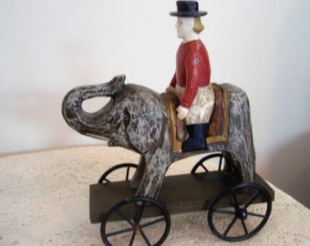 "Wood Man on Elephant on Metal Wheels,Vintage wood pull toy display, Reproduction pull toy, 10"" x 9"" collectible Elephant"