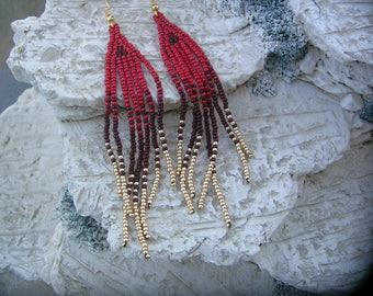 Red fringe earrings.