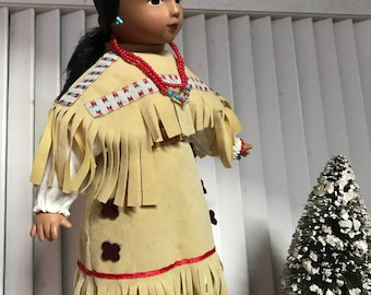 Indian Princess, Hand Painted Face, Head, hands and legs are china, Beatiuful Suede like Costume, Authentic Costume Colored Beads
