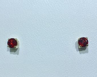 Genuine Mozambique garnet 4 millimeter round 14k yellow gold stud earrings