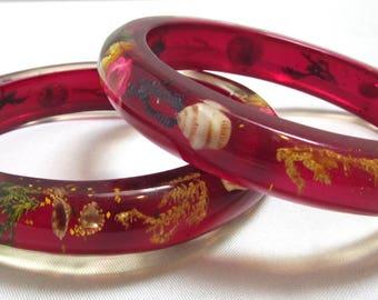Two Lucite Bangle Bracelets Imbedded Shells Flowers Seaweed