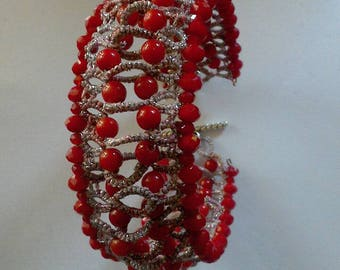 Tatting with red coral bracelet