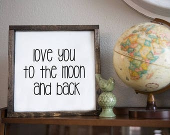 love you to the moon and back.  13.5x13.5 distressed wood sign.  white with black writing