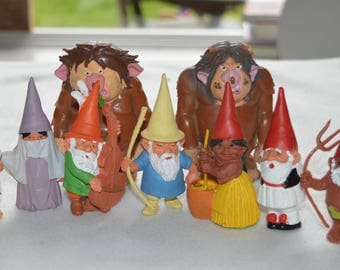 Two (2) trolls and seven (7) gnomes after a design of Rien Poortvliet
