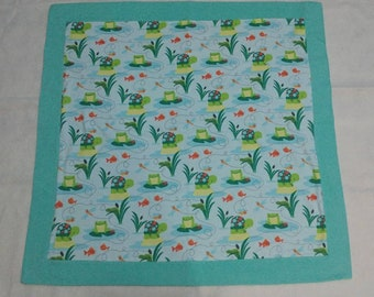 Flannel baby blanket with turtles and frogs.
