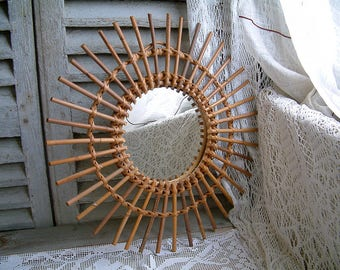 French vintage rattan and wicker sunburst mirror. 1970s sunburst wall mirror. Rattan sunburst mirror. Natural home decor. Costal cottage