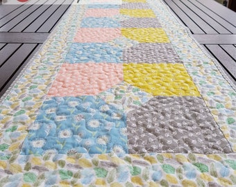 Quilted table runner in pastel prints