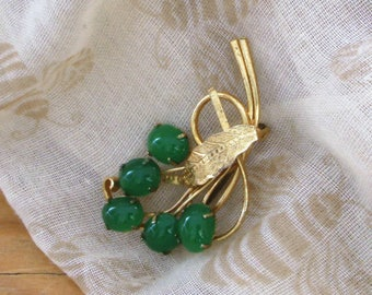 Vintage green flower brooch with gold leaves and stems