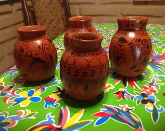 Vintage set of 4 hand decorated terra cotta red clay Mexican jugs or ollas