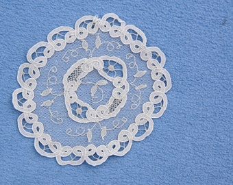 """Delicate lace doily, white, approximately 5-1/4"""" diameter"""