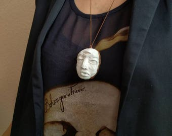 Ceramic sculpted face copper electroforming  around the edge and copper chain