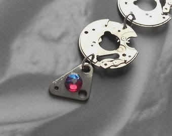 Earrings created in stainless steel watch parts